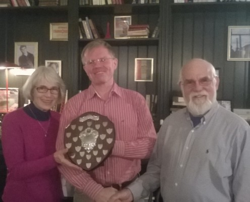 Mike Brett (centre) is presented with the Maycraft Trophy by 2013 winner Jennifer Taylor and Club Secretary Ray Curtis.